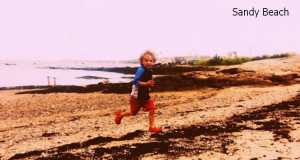 child runs on Sandy Beach