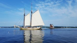Sailing in Maine View of Schooner Heritage and Rockland Breakwater